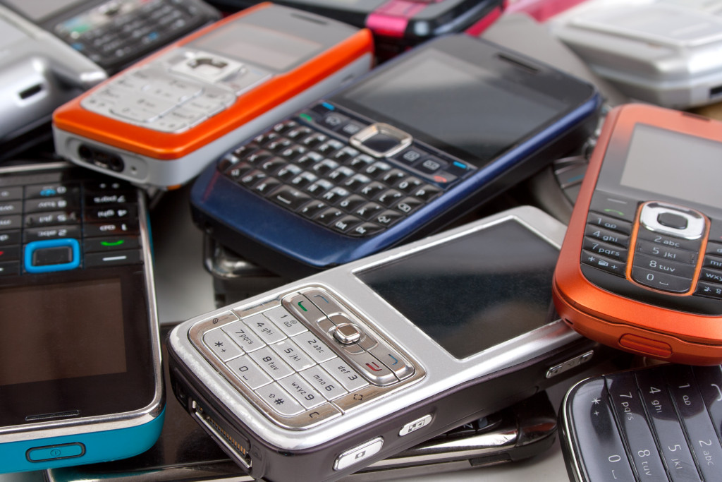 Cell phones closeup, old ones and newer ones