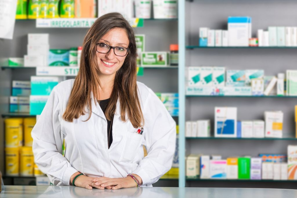 Beautiful Pharmacist Portrait in a Drugstore