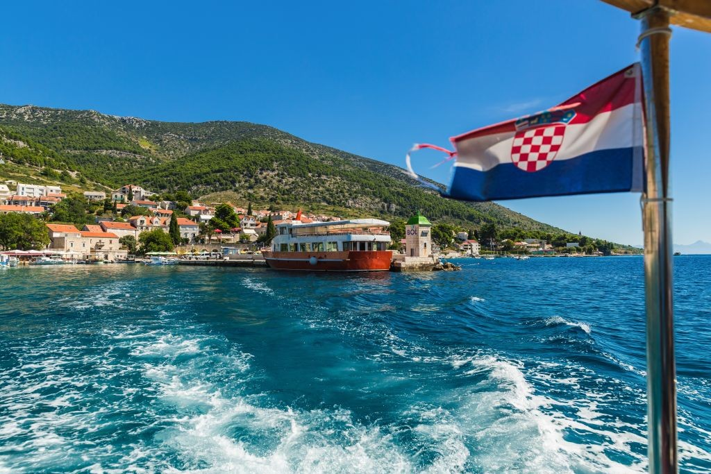 Croatian Bol city on Brac island view from sea .