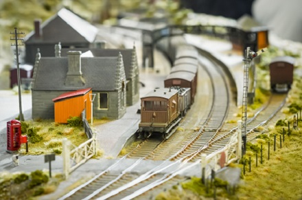 rural model railway station and train