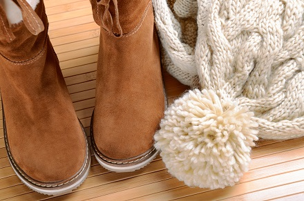 winter boots, hat and scarf on the floor