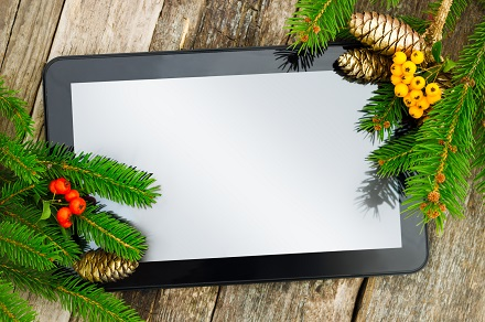 Tablet on Christmas tree brunch