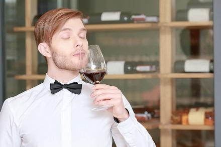 Sommelier testing red wine