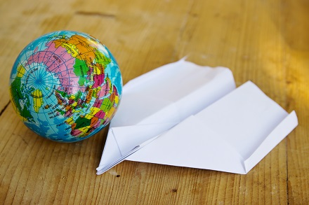 Globe Earth and Paper Airplane
