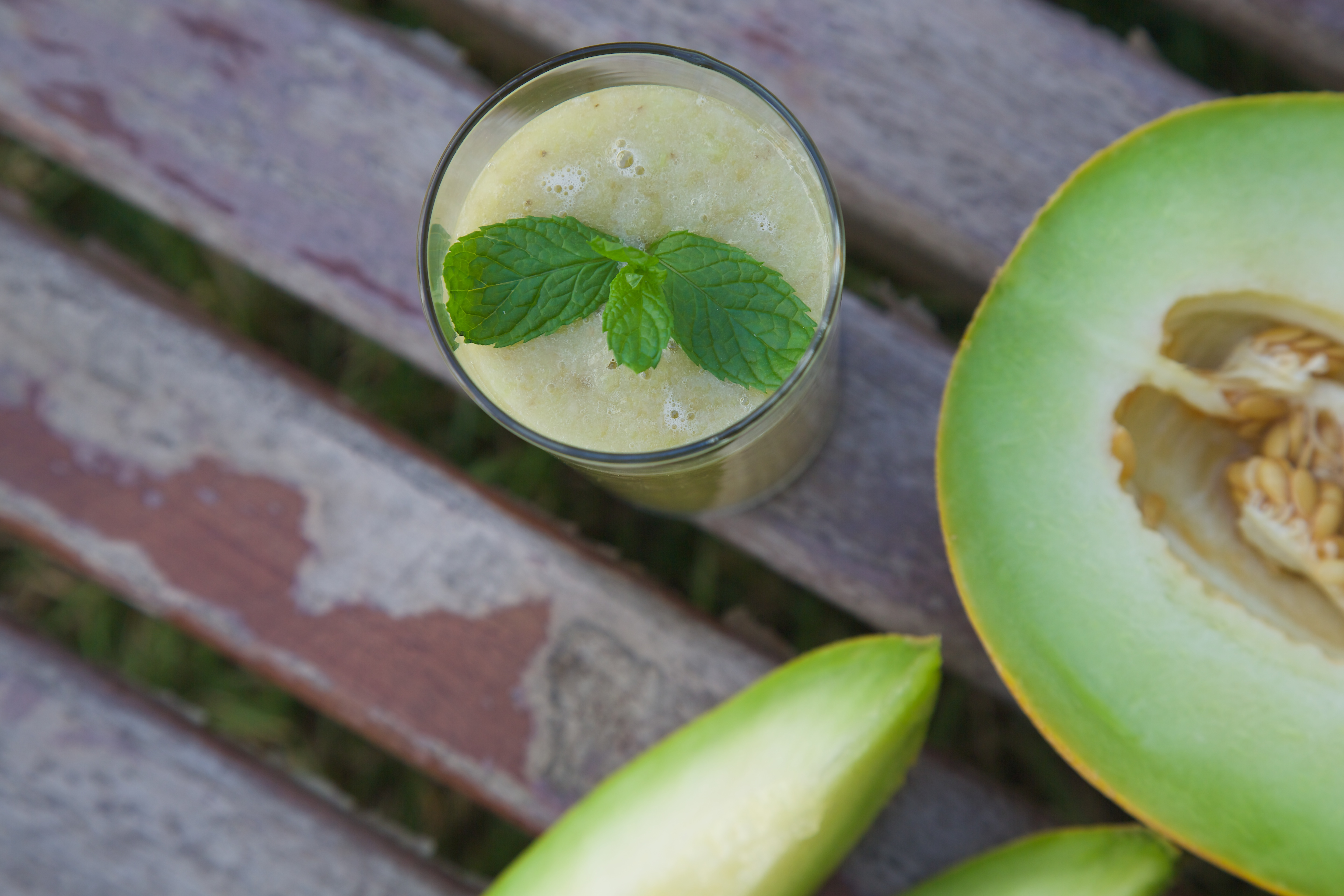 Melon smoothie with fresh peppermint leaves